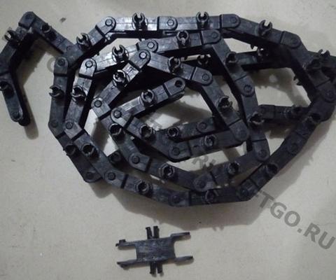 Звено пластиковое цепи торца балюстрады Kone R20 (без роликов)